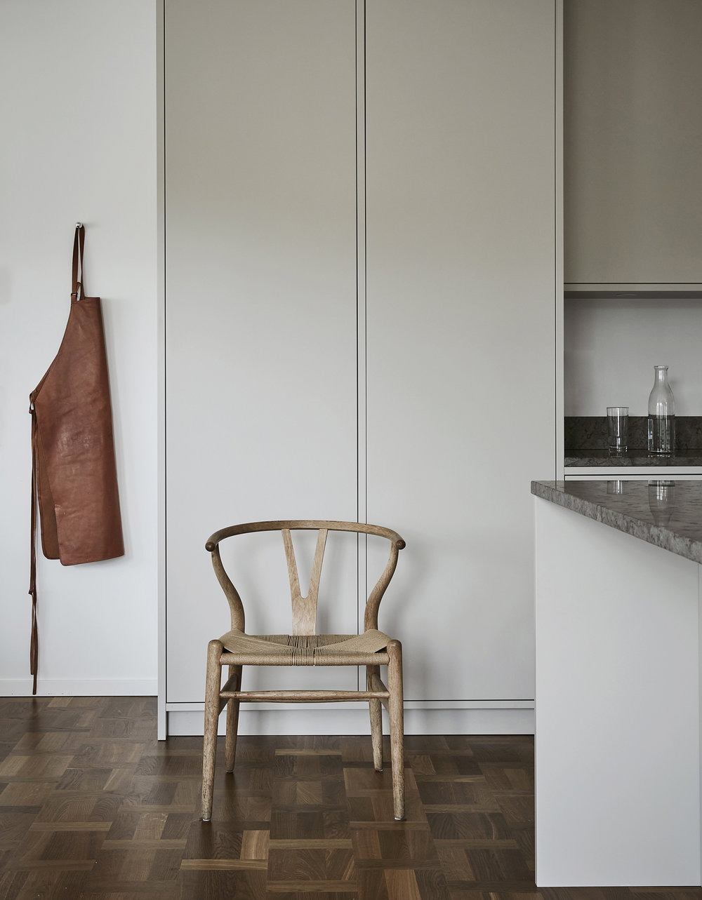apron and chair in a minimalistic kitchen by Sundlingkicken for Nordiska Kök